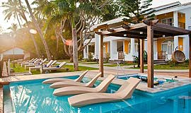 Relaxing pool at Acron Waterfront Resort in Goa